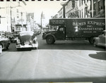 Traffic congestion caused by trucks loading and unloading during peak traffic hours, ca. 1954.