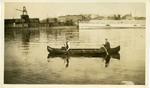 Two Men in woodstrip Canoe Georgia in front of Eastern Steamship Co