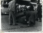 Al Brady being removed from the street by the undertakers