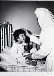 Nurse with child patient at St. Joseph Hospital, Bangor, ca. 1960